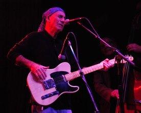 Jim onstage, pink light