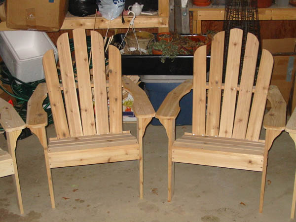 set of pine and a set of cedarAdirondack chairs.