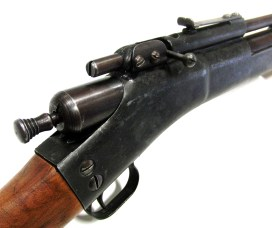 Single shot Apache air rifle with bolt action probe and loading port on top of the receiver.