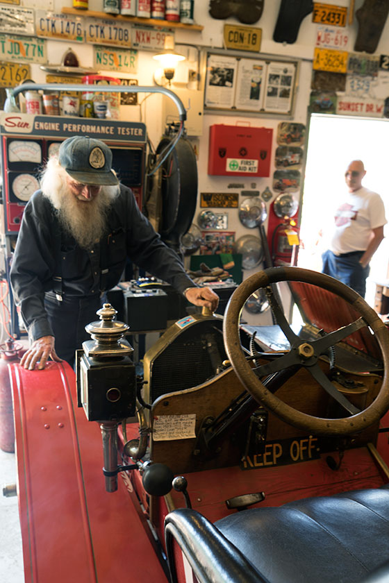 Marl starts antique car.