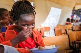 One of our primary school students enjoying lunch during our 2017 Children's Day.