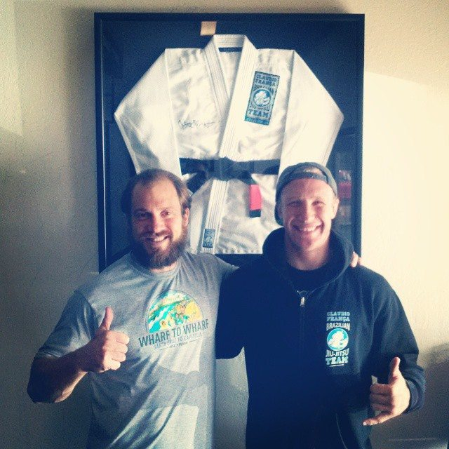 Greg Amundson and Nathan pose in front of Nathan's gi at Crossfit Amundson--photo courtesy of Nathan Mendelsohn