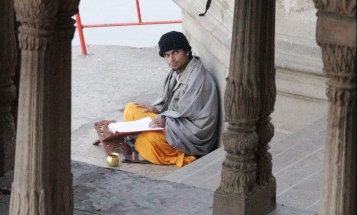 devotee studying shastra