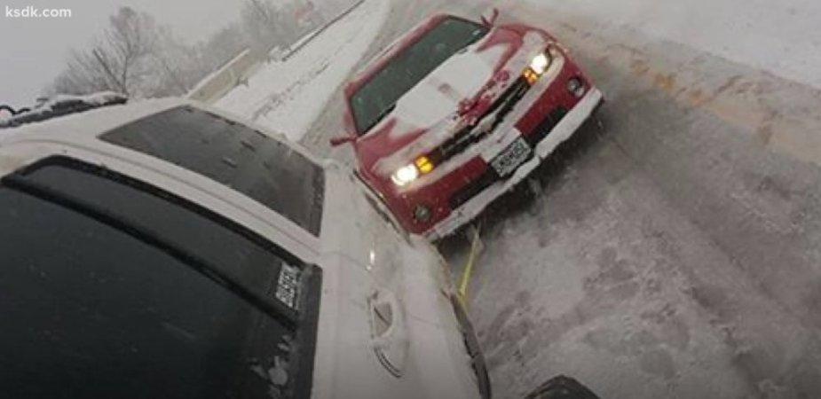 Jeep Pulling a Camaro
