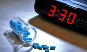 Sleeping pills by the clock.