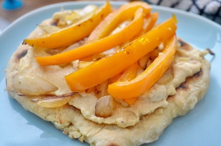 Flatbreads with houmous, peppers, and onions