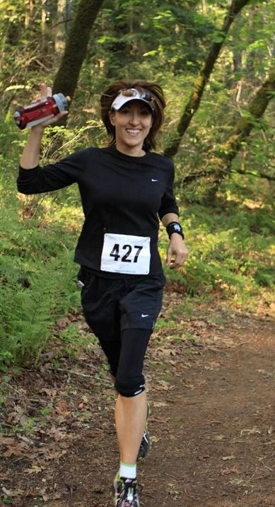 A photo of Joan Jakel running a half marathon on the trails of Bothe park in Northern CA