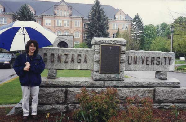 Photo of Joan Jakel standing next to the Gonzaga University Monument