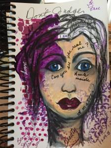 a photo of An art journal face created for a coach friend