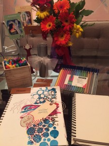 Photo of art journal page, markers and flowers, which is a setting for participants of the VIP Retreat Day as they design their authentic and fulfilling lives.