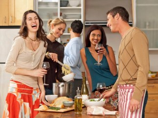 photo of a groupof people enjoying each other's company and celebrating after successfully designing their fulfilling life after completing the Create Your Inspired Life program.