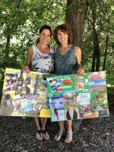 A photo of Denise and Joan sharing their vision boards
