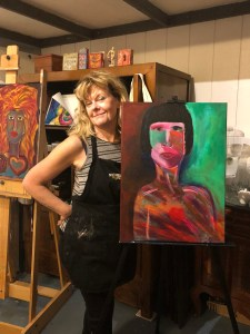 An image of artist Katrena Edman standing next to her painting on an easel and the painting is an abstract woman
