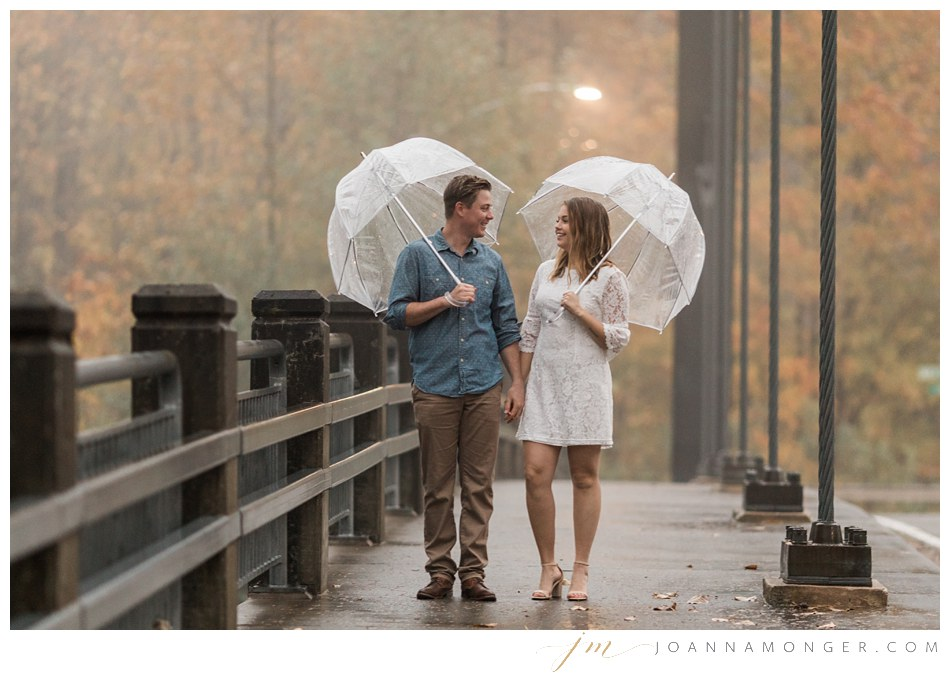 A couple holds hands during a rainy engagement shoot in Snohomish, WA. | Joanna Monger Photography | Snohomish & Seattle Wedding Photographer