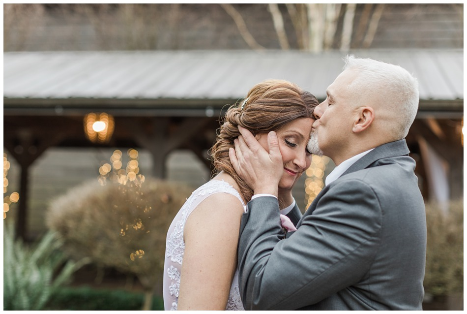 A groom kisses his bride before their a special winter wedding at Hidden Meadows, a wedding venue in Snohomish near Seattle, WA. | Joanna Monger Photography | Snohomish & Seattle Wedding Photography