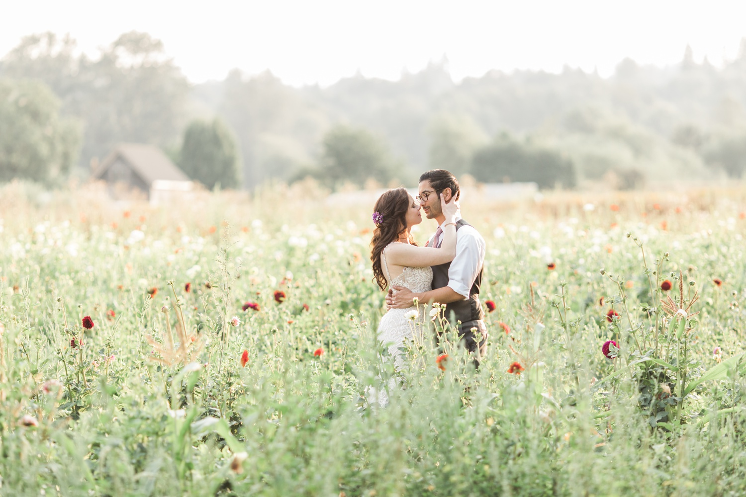 A bride and groom kiss in a field of flowers before their wedding at Woodland Meadow Farms in Snohomish, a wedding venue near Seattle, WA. | Joanna Monger Photography | Seattle & Snohomish Photographer
