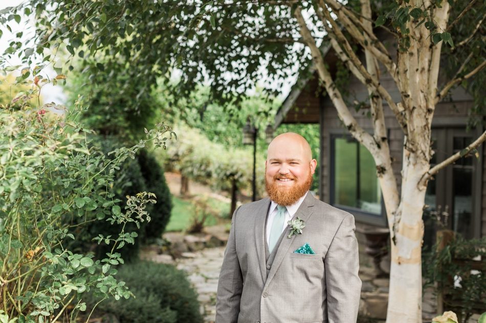 Photo of groom smiling at a Hidden Meadows Farms wedding in Snohomish, a rustic yet elegant wedding venue near Seattle.   Joanna Monger Photography
