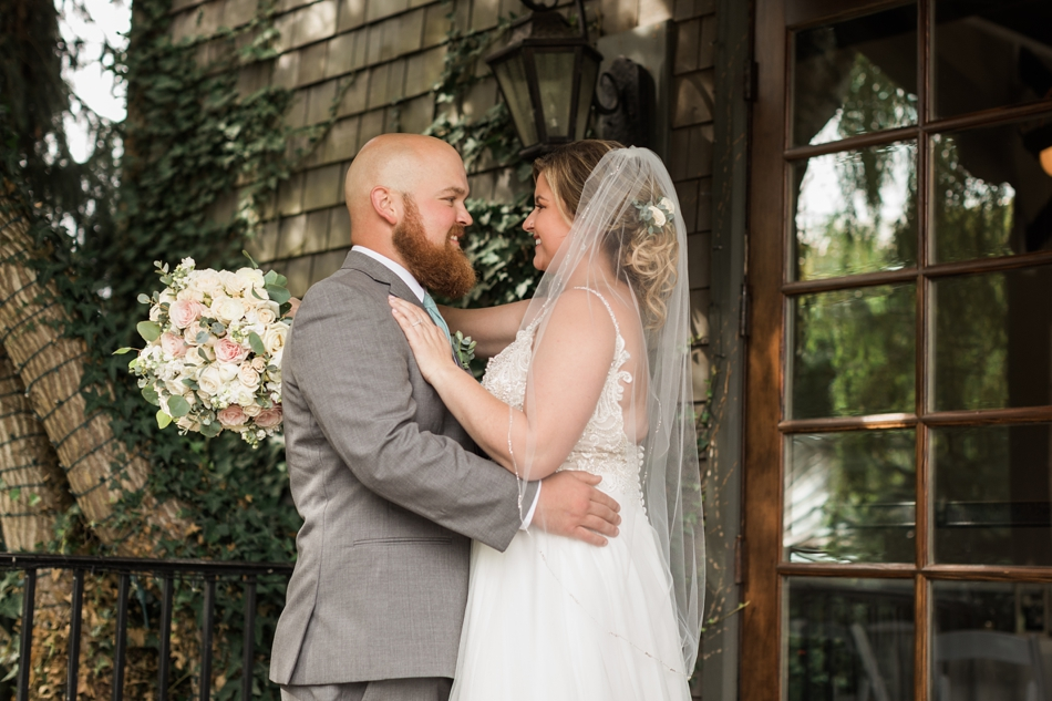 Photo of bride and groom embracing at a Hidden Meadows Farms wedding in Snohomish, a rustic yet elegant wedding venue near Seattle. | Joanna Monger Photography
