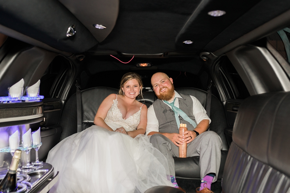 Photo of newlywed couple leaving in a limo after a Hidden Meadows Farms wedding in Snohomish, a rustic yet elegant wedding venue near Seattle. | Joanna Monger Photography