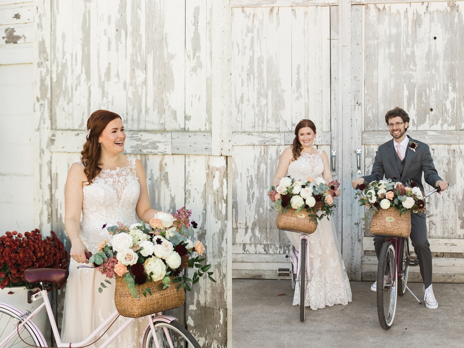 Photo of bride and groom on vintage bikes in front of white-wash barn at Snohomish Wedding Venue Dairyland Barn near Seattle | Joanna Monger Photography