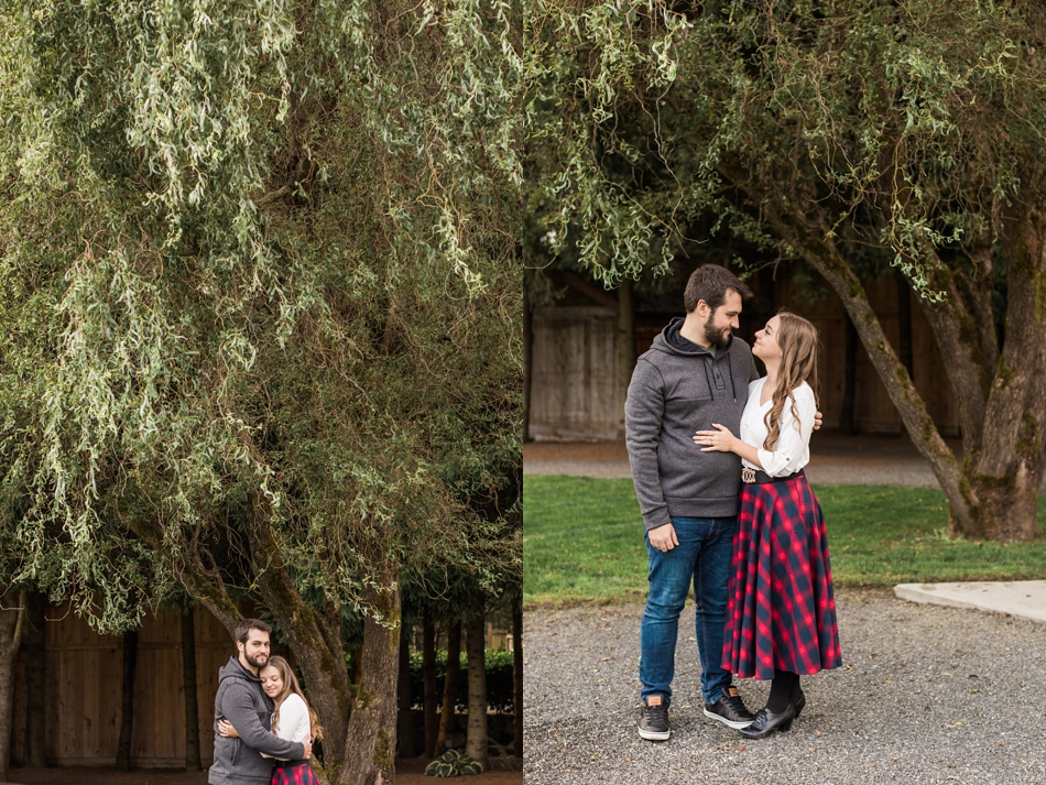 rainy engagement photos under a tree at Woodland Meadow Farms in Snohomish, WA