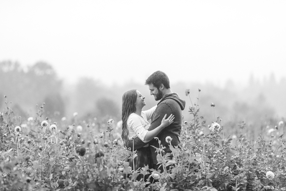 Snohomish Engagement photographs at Woodland Meadow Farms in flower field in rain