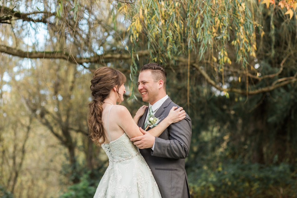 A photo of a bride and groom's first look at one another before their fall wedding at the Loft at Russell's in Bothell, a wedding venue near Seattle. | Joanna Monger Photography | Snohomish & Seattle Wedding Photographer