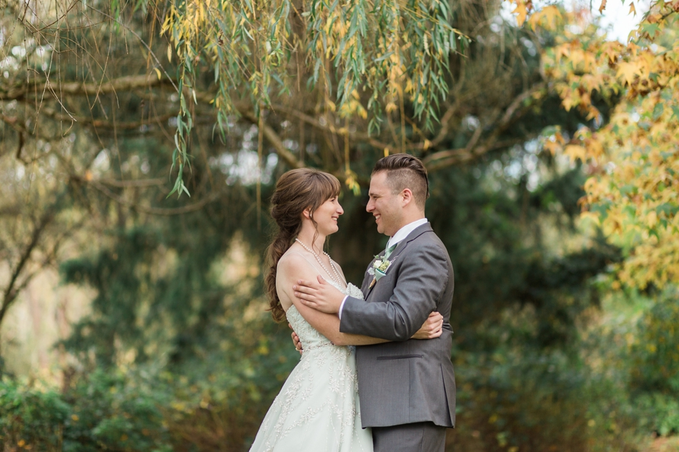 A photo of a bride and groom lovingly embracing before their fall wedding at the Loft at Russell's in Bothell, a wedding venue near Seattle. | Joanna Monger Photography | Snohomish & Seattle Wedding Photographer