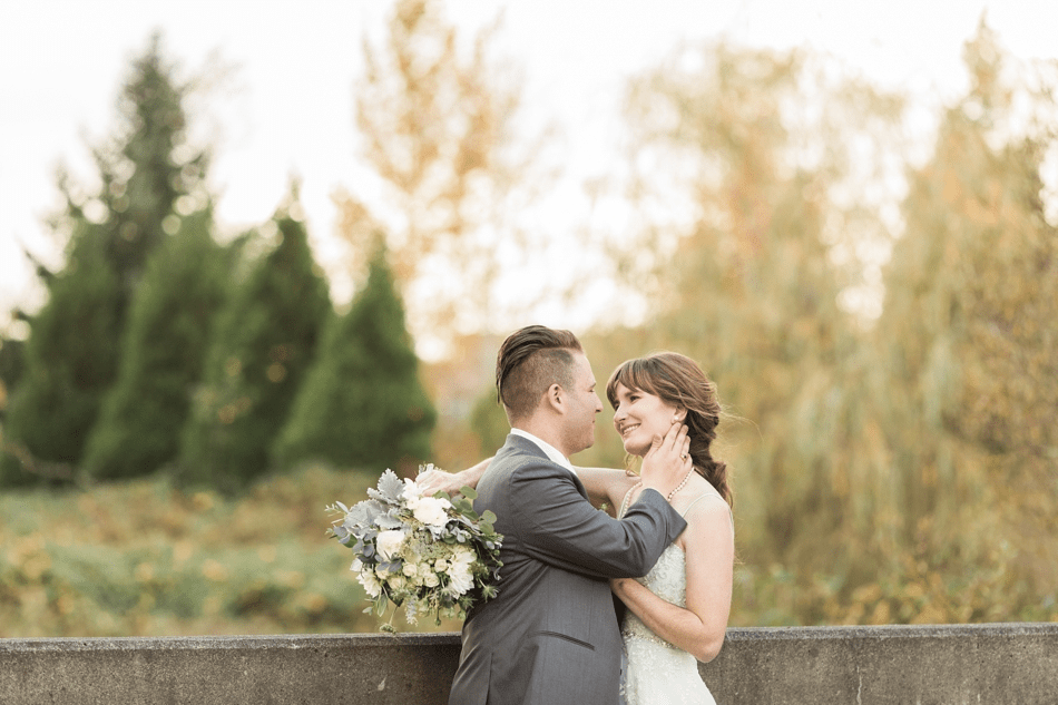 A photo of a bride and groom lovingly looking at each other before their fall wedding at the Loft at Russell's in Bothell, a wedding venue near Seattle. | Joanna Monger Photography | Snohomish & Seattle Wedding Photographer