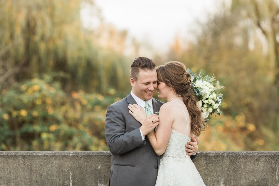 A bride and groom embrace before their fall wedding at the Loft at Russell's in Bothell, a wedding venue near Seattle. | Joanna Monger Photography | Snohomish & Seattle Wedding Photographer
