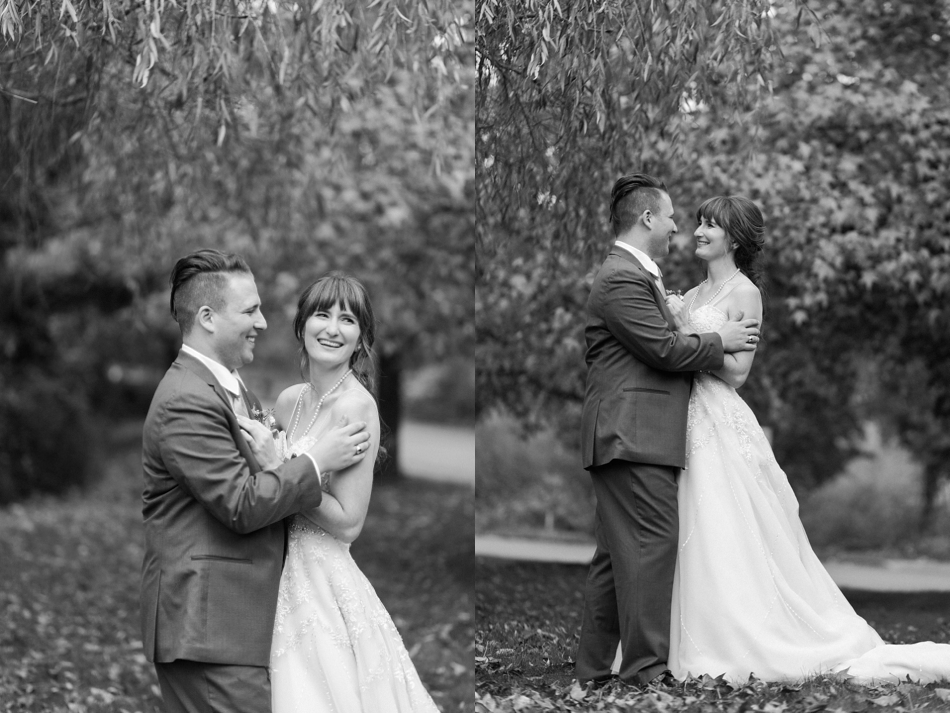 A black and white photo of a bride and groom embracing before their fall wedding at the Loft at Russell's in Bothell, a wedding venue near Seattle. | Joanna Monger Photography | Snohomish & Seattle Wedding Photographer