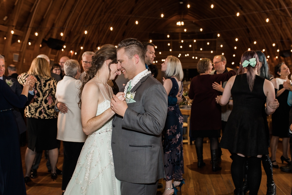 A photo of a bride and groom dancing during their fall wedding at the Loft at Russell's in Bothell, a wedding venue near Seattle. | Joanna Monger Photography | Snohomish & Seattle Wedding Photographer