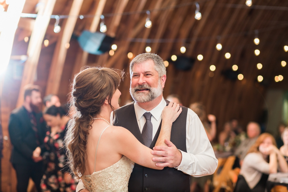A photo of a bride dancing with her father during her fall wedding at the Loft at Russell's in Bothell, a wedding venue near Seattle. | Joanna Monger Photography | Snohomish & Seattle Wedding Photographer
