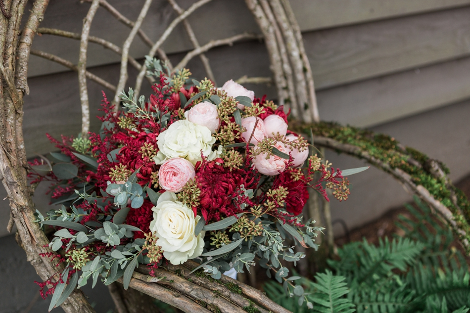 A photo of the lush burgundy, rose, and white floral arrangement from a winter wedding at Hidden Meadows in Snohomish, a wedding venue near Seattle, WA. | Joanna Monger Photography | Snohomish & Seattle Wedding Photographer