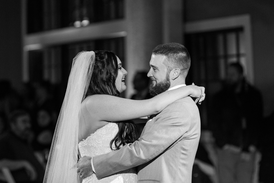 A black-and-white photo of a bride and groom during their first dance of a winter wedding at Hidden Meadows in Snohomish, a wedding venue near Seattle, WA. | Joanna Monger Photography | Snohomish & Seattle Wedding Photographer