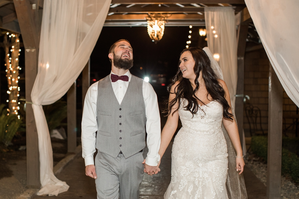 A bride and groom hold hands and laugh after their winter wedding at Hidden Meadows in Snohomish, a wedding venue near Seattle, WA. | Joanna Monger Photography | Snohomish & Seattle Wedding Photographer
