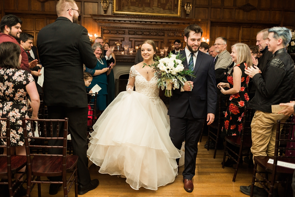 A bride and groom walk down the aisle after their ceremony of a regal winter wedding at Thornewood Castle in Lakewood, a wedding venue near Seattle, WA. | Joanna Monger Photography | Seattle & Snohomish Wedding Photographer