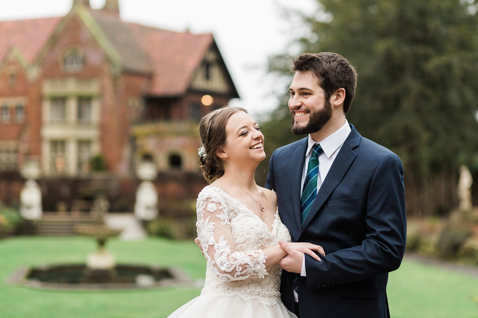 A bride and groom embrace after their regal winter wedding at Thornewood Castle in Lakewood, a wedding venue near Seattle, WA. | Joanna Monger Photography | Seattle & Snohomish Wedding Photographer