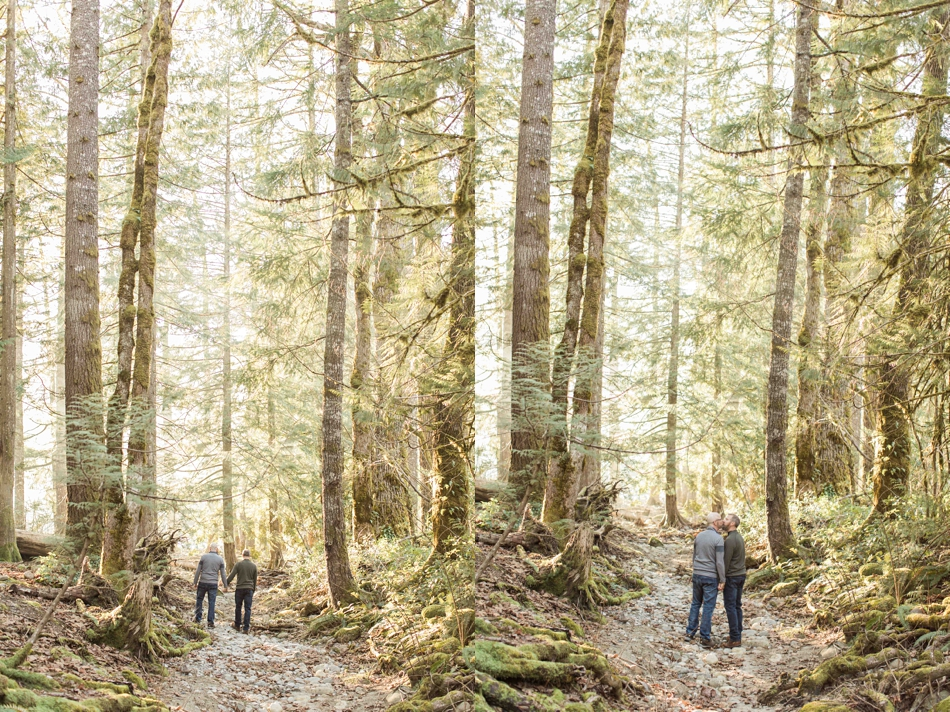 An engaged couple walk through the woods during their spring outdoor mountain engagement shoot in Snohomish, near Seattle, WA. | Joanna Monger Photography | Snohomish Wedding Photographer