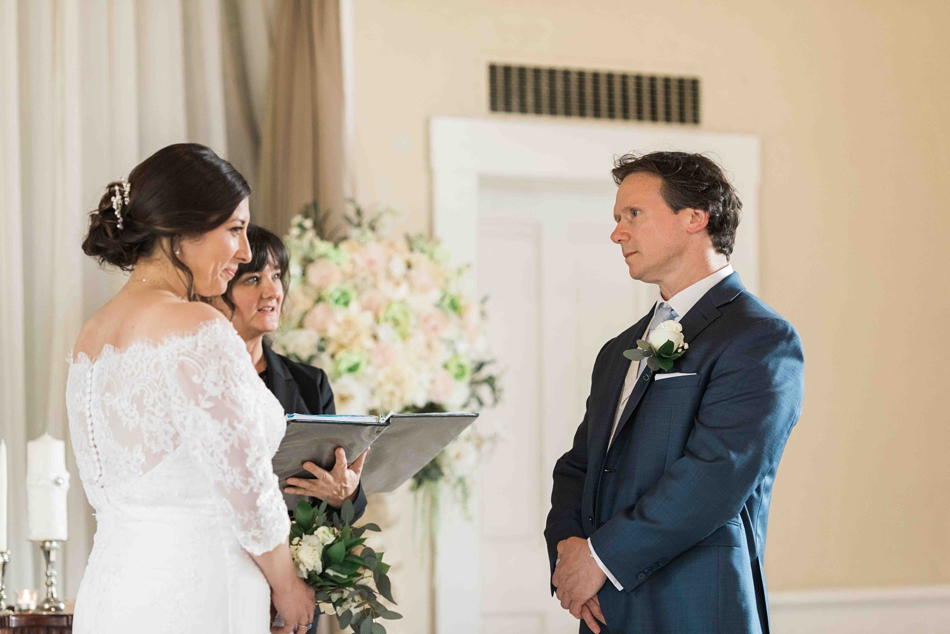 A bride and groom exchange vows during their intimate wedding at Belle Chapel in Snohomish, a wedding venue near Seattle, WA. | Joanna Monger Photography | Snohomish Wedding Photographer