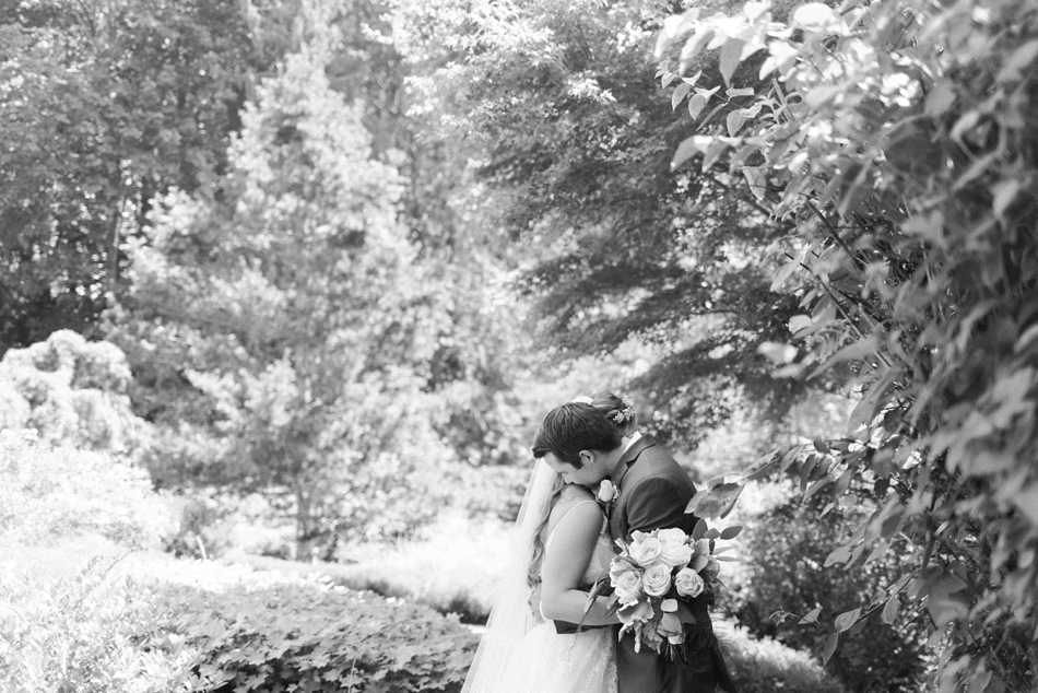 A black and white cuddle at Twin Willow Gardens in Snohomish. Photos by Joanna Monger Photography, Snohomish and Seattle Wedding Photographer.