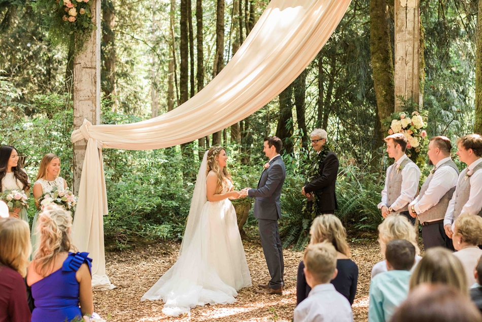 Under fir trees at Twin Willow Gardens in Snohomish. Photos by Joanna Monger Photography, Snohomish and Seattle Wedding Photographer.