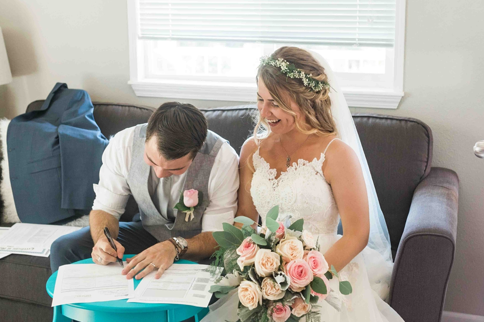Signing the papers at Twin Willow Gardens in Snohomish. Photos by Joanna Monger Photography, Snohomish and Seattle Wedding Photographer.