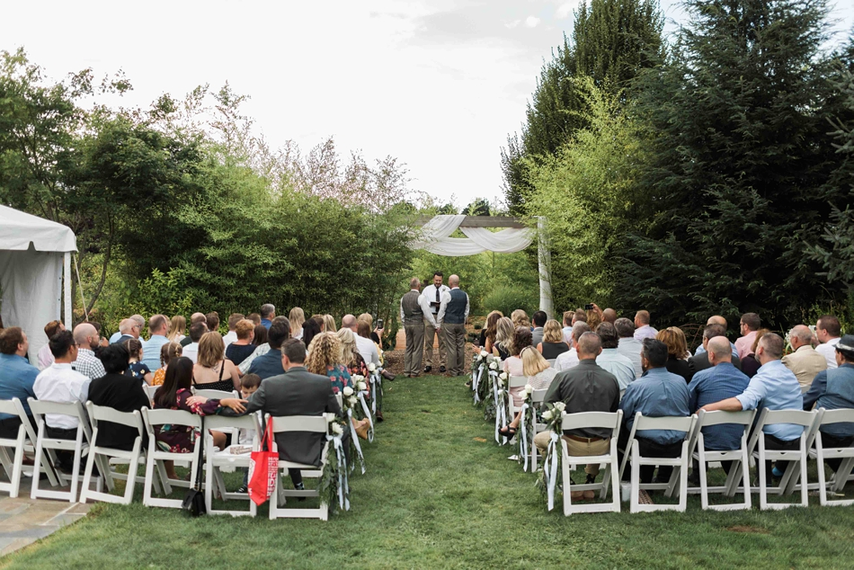 The ceremony at Falling Water Gardens in Monroe. Photos by Joanna Monger Photography, Snohomish and Seattle Wedding Photographer.