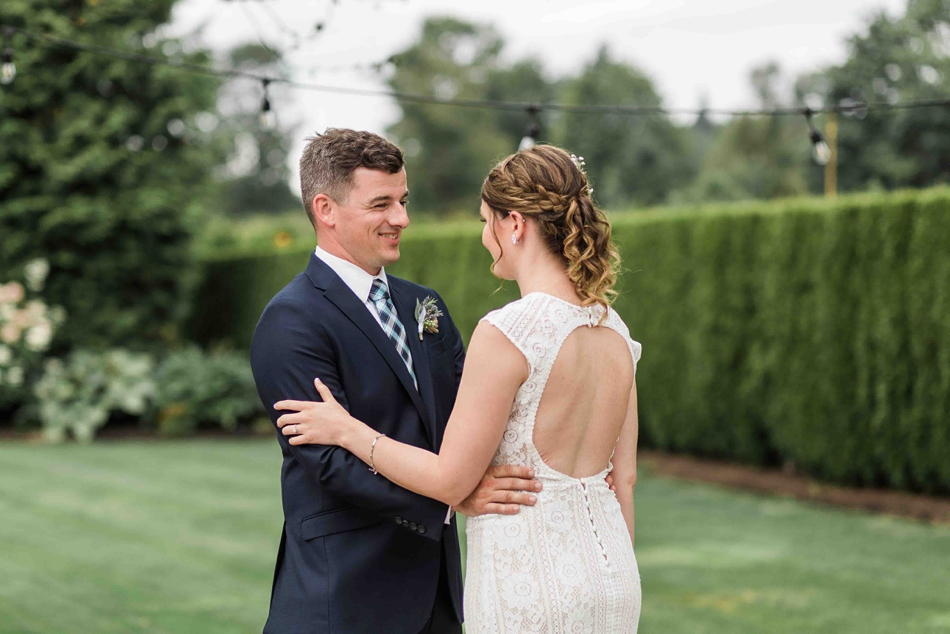 Holding each other at Pine Creek Nursery in Monroe. Photos by Joanna Monger Photography, Snohomish and Woodinville Wedding Photographer.
