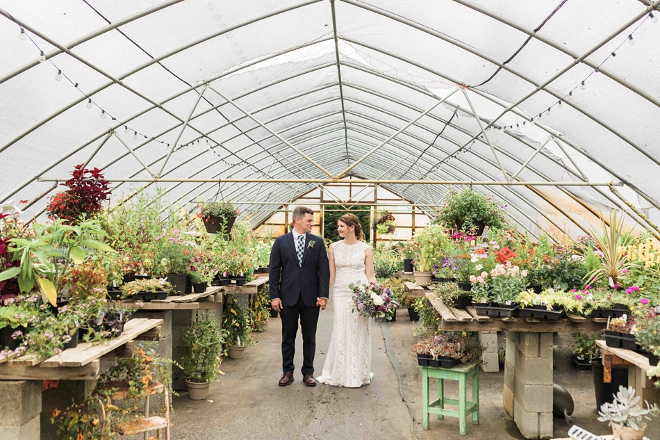 The bride and groom gaze at each other at Pine Creek Nursery in Monroe. Photographs by Joanna Monger Photography, Snohomish's Best Wedding Photographer.