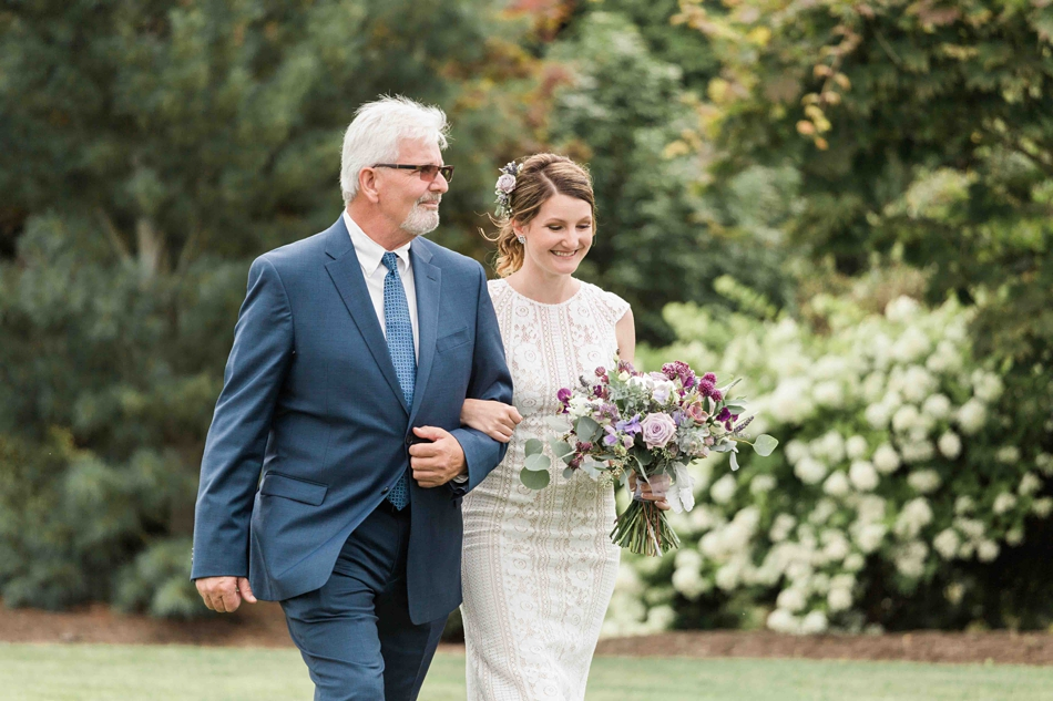 Walking down the aisle at Pine Creek Nursery in Monroe. Photos by Joanna Monger Photography, Snohomish and Seattle Wedding Photographer.