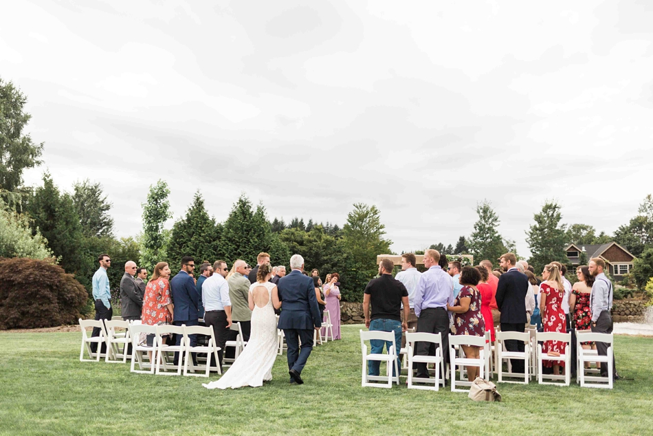 The guests watch at Pine Creek Nursery in Monroe. Photos by Joanna Monger Photography, Snohomish and Seattle Wedding Photographer.