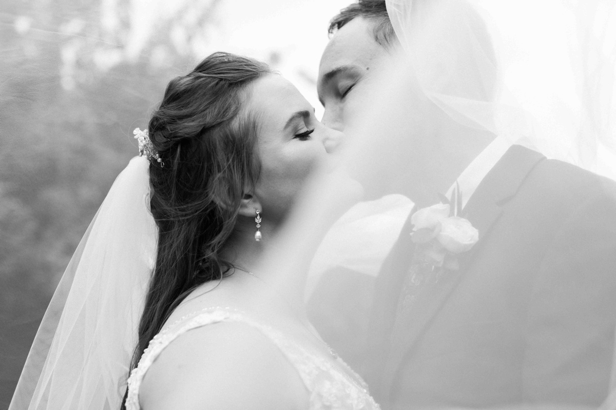 Romantic kiss at Craven Farms in Snohomish. Photographs by Joanna Monger Photography, Snohomish's Best Wedding Photographer.