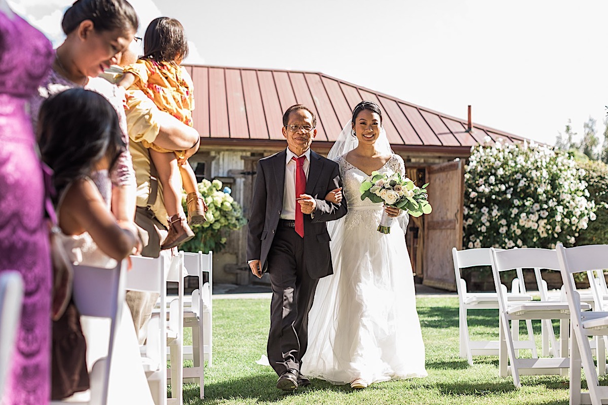 Walking down the aisle at Craven Farms in Snohomish. Photographs by Joanna Monger Photography, Award Winning Snohomish Wedding Photographer.